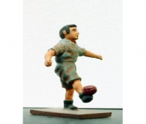 Boy Kicking A Football